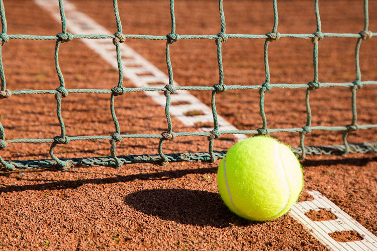 Ball Close-up Competition Competitive Sport Court Day Leisure Activity No People Outdoors Racket Sport Sport Sports Equipment Tennis Tennis Ball Tennis Net