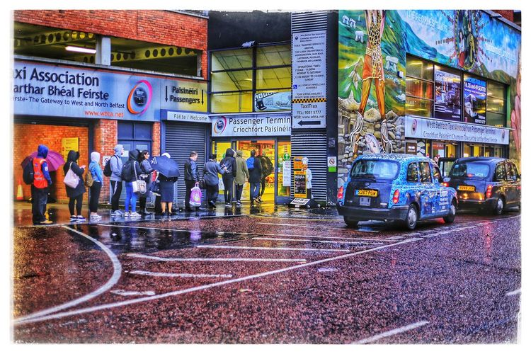Transportation Outdoors City Taxi Taxirank Blacktaxi Queueing Queue Rainy Days Rainy People Cityscape Citylife Real People Belfast Belfastcity Béalfeirste Ireland Streetphotography Autumn Umberella Taxicab Taxicabs Cabs Rain