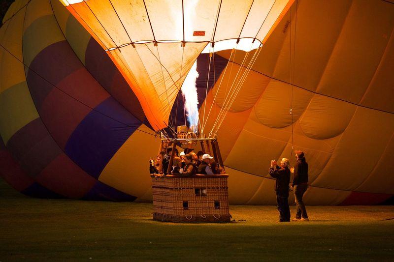 Man standing in hot air balloon