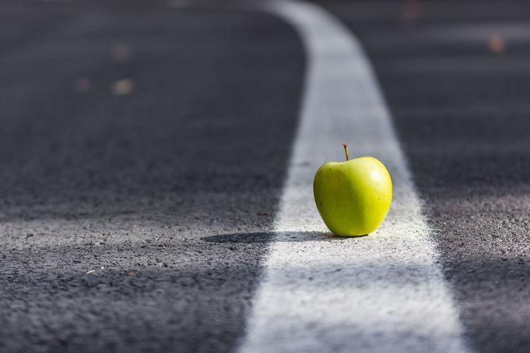Close-up of apple on leaf