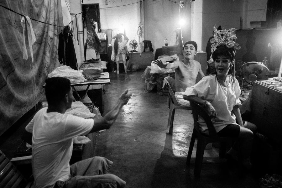Chinese opera actor and actress having chit chat in dressing room. Architecture Back Stage Black And White Collection  Casual Clothing Chinese Chit Chat Cultural Dressing Up Full Length Heritage Illuminated Looking Monochrome Night Opéra Person Photography Side View Sitting Standing Well-dressed