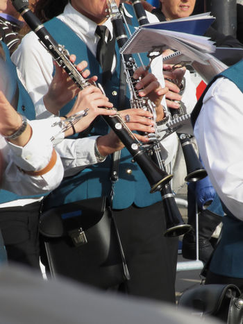 Clarinets in the hands of the musicians in the orchestra Acoustic Adult Caucasian Clarinet Clarinetist Classical Concert Ensemble Entertainment Event Fashion Finger Human Instrument Music Musician Orchestra People Performer  Person Playing Sound Symphony Traditional Woodwind