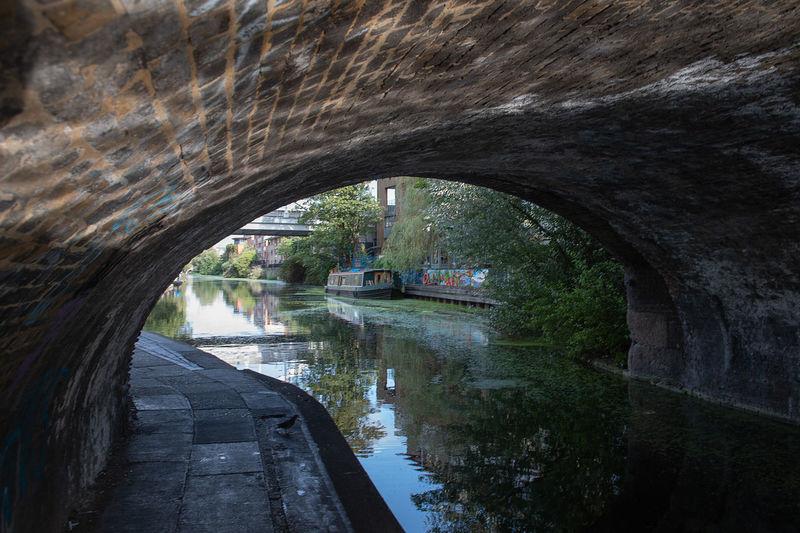 Arch bridge over river in tunnel