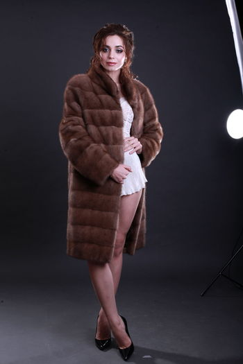 Fashion Fashion Model Fashion Photography Fur Fur Coat Style Editorial  Gray Background Studio Shot Glamour Glamour Shots Elégance Model Full Length Looking At Camera Indoors  Young Adult Clothing Adult Beauty Standing Lifestyles Shoe Warm Clothing Black Background
