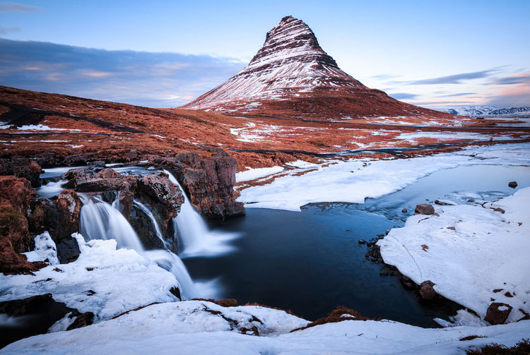 got some great light for my stop at Kirkjufell & Kirkjufellsfoss Beauty Beauty In Nature Cold Temperature Dusk Iceland Kirkjufell Kirkjufellsfoss Landscape Mountain Mountain Peak Nature No People Outdoors Scenics Sky Snow Sunset Tourism Travel Travel Destinations Vacations Water Waterfall Winter
