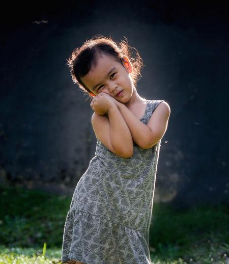Cute girl standing on field