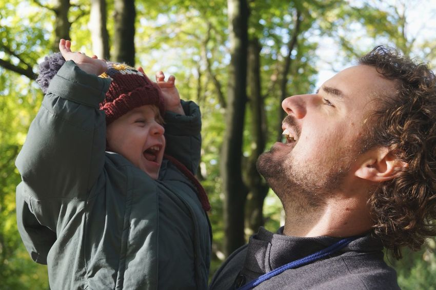 Celebrating life Smiling Two People Togetherness Cheerful Headshot Fun Child Happiness Love Outdoors Bonding Young Adult Father And Son Fatherhood Moments Forest EyeEm Best Shots Light And Shadow The Week On EyeEm Autumn Celebrating Life Nature Boy Hat Looking At Each Other Laughing This Is Masculinity