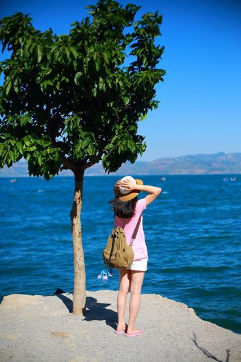 Tourism Lake Rear View One Person Nature Full Length Real People Tree Outdoors Day Water Blue Beauty In Nature Casual Clothing Standing Scenics Women Horizon Over Water