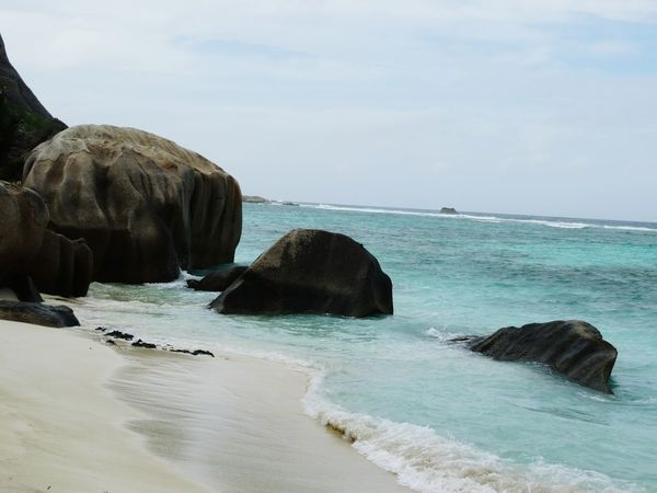 Sea Rock - Object Beach Beauty Water Cloud - Sky Nature No People Sky Beauty In Nature Sand Tranquility Outdoors Travel Destinations Day Relaxation Horizon Over Water Seychelles Seychelles Islands La Digue Tropical Paradise Indian Ocean