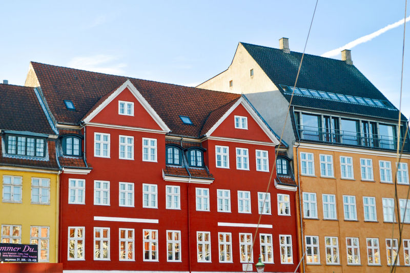 d a n i s h Outdoors Travel Travel Destinations Copenhagen Copenhagen, Denmark History Historic Old Colors Colorful Window Windows Architecture Architecture_collection Architectural Feature Architectural Detail Architecturelovers Modern Architecture Modern Man Made Man Made Structure Built Structure Building Exterior Building House Row House No People Residential District City Sky Day Red Nature Roof In A Row Low Angle View Communication Sunlight Housing Development The Architect - 2019 EyeEm Awards