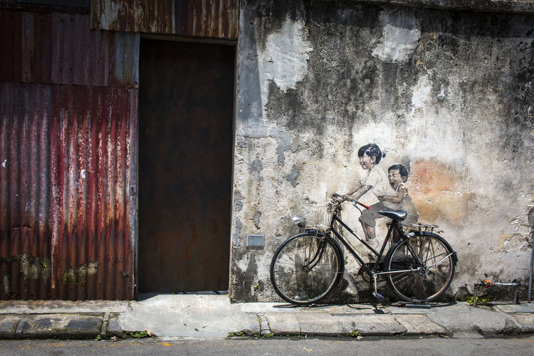 Bicycle parked against wall in building