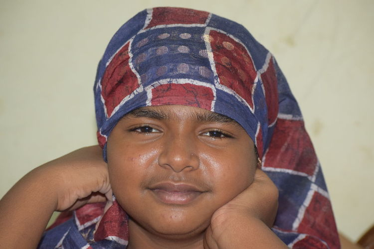 Close-up portrait of smiling boy wearing scarf