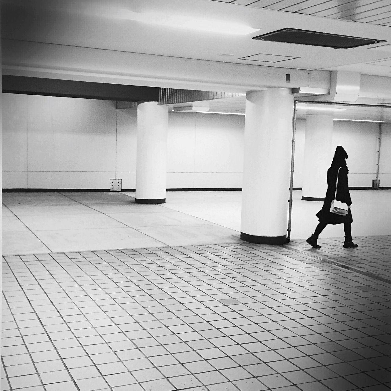 Silhouette Woman Walking In Subway