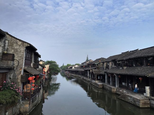 Architecture Building Exterior Built Structure Canal City City Life Clear Sky Day House Narrow No People Reflection Residential Structure River Riverbank Sky Standing Water Town Travel Destinations Water Waterfront