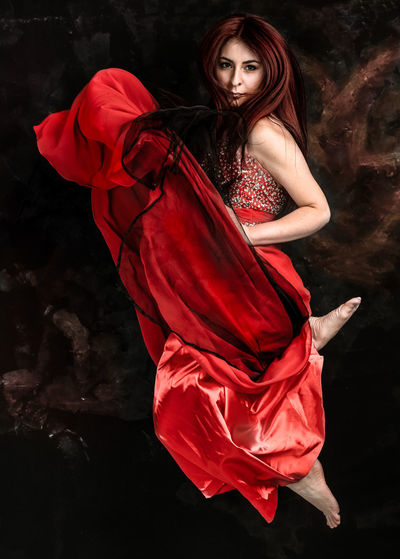 red head woman in motion The Portraitist - 2019 EyeEm Awards Young Women Portrait Black Background Beautiful Woman Beauty Full Length Beautiful People Studio Shot Females Red Hairstyle Society Beauty Fashion Model Haute Couture Cocktail Dress