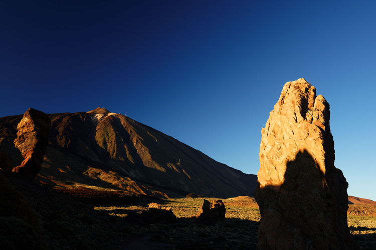 Scenic view of mountain against clear blue sky at teide national park
