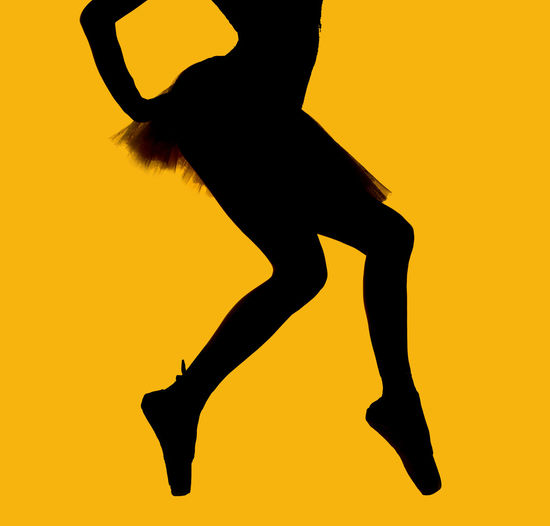 Black silhouette of ballerina isolated over yellow background Artist Balance Ballerina Ballet Ballet Dancer Ballet Shoes Ballet Tutu Black Silhouette Bodice Body Part Choreography Cut Out Dancer Elegant Graceful Isolated Outline People Pointe Shoes Pose Prima Silhouette Slim Woman Yellow Background
