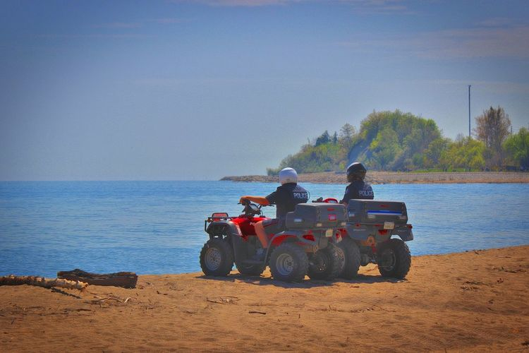 Toronto Police officers patrol West Rouge beach on Atv ... Police Policeman Police At Work Police Patrol Law Enforcement