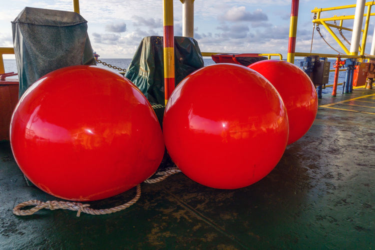 Norwegian buoy on barge deck Inflatable  Mooring Floatation Device Norwegian Float Equipment Marker Barge Nautical Maritime Offshore Offshore Life Sea Ocean Buoy Boat Nautical Vessel Port Shore