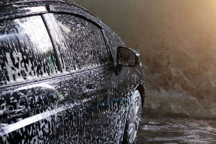 Selective focus of Black Car wash with soap and sunlight filter effect Automobile Car Wash Car Washing Transport Transportation Washing Auto Automotive Car Car Wash Day Close-up Day Foam Land Vehicle Mode Of Transport Nautical Vessel No People Outdoors Rain RainDrop Tire Transportation Wash Water Wet