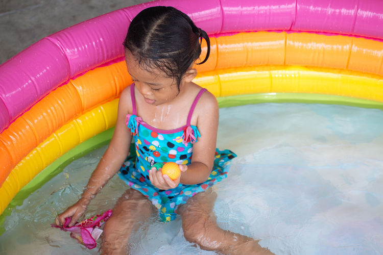 Girl Playing In Wading Pool