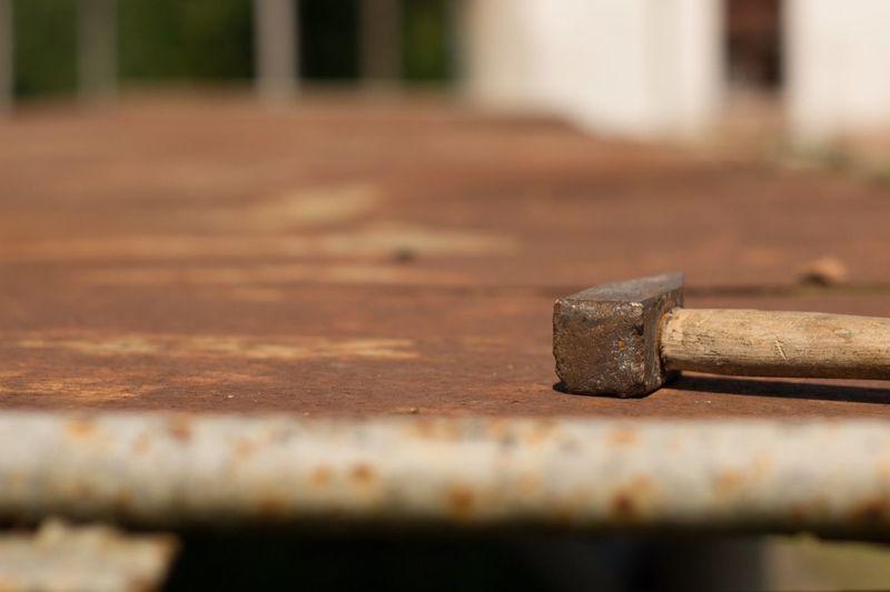 Hammer on rusty workbench