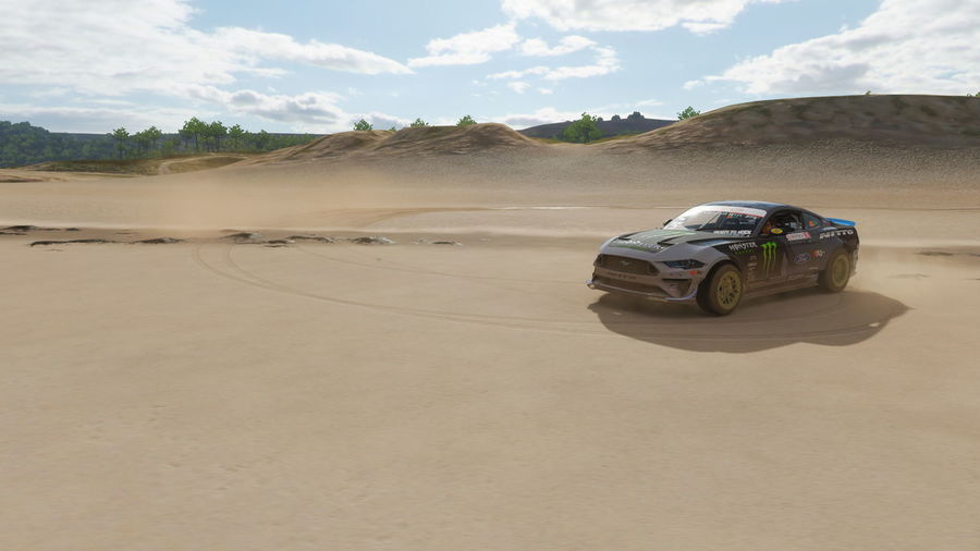 View of car on desert land