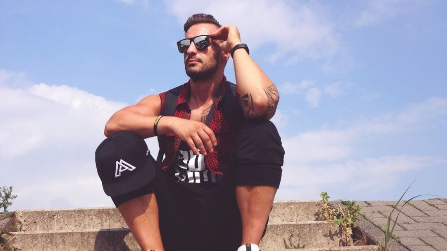 Summertime Sadness 🌞 EyeEm Selects Sky Glasses Young Men Young Adult Fashion Sunglasses Cloud - Sky Real People Lifestyles Leisure Activity One Person Nature Low Angle View Casual Clothing Front View Men Beard Three Quarter Length Outdoors Day