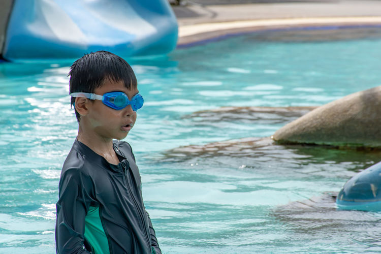 Asian boys are swimming in the pool. Water One Person Real People Leisure Activity Males  Men Boys Portrait Childhood Lifestyles Sea Child Day Headshot Focus On Foreground Waist Up Swimming Pool Outdoors Innocence Turquoise Colored Eyewear