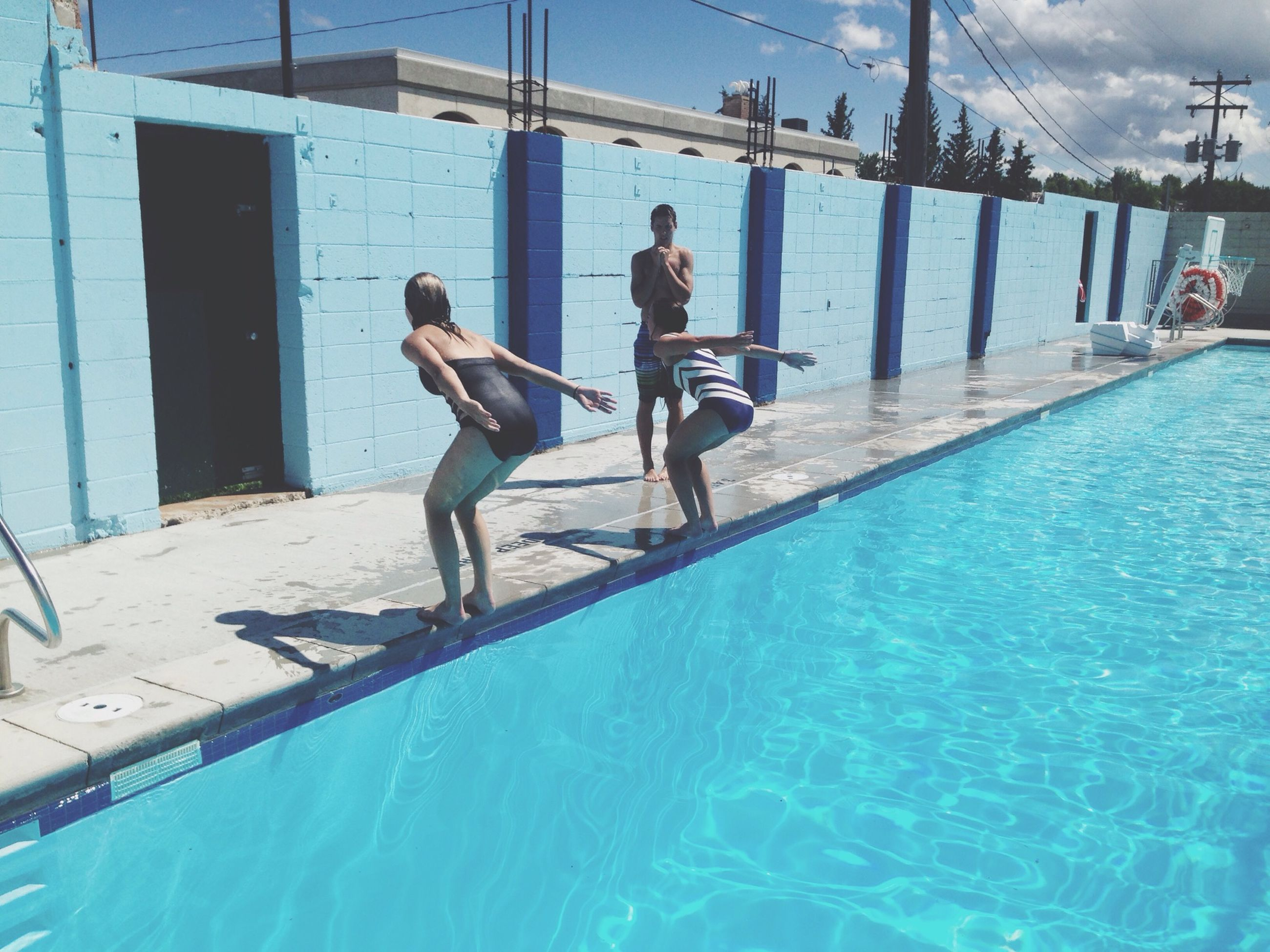 lifestyles, water, leisure activity, full length, men, blue, built structure, sea, boys, togetherness, architecture, waterfront, enjoyment, person, swimming pool, day, fun