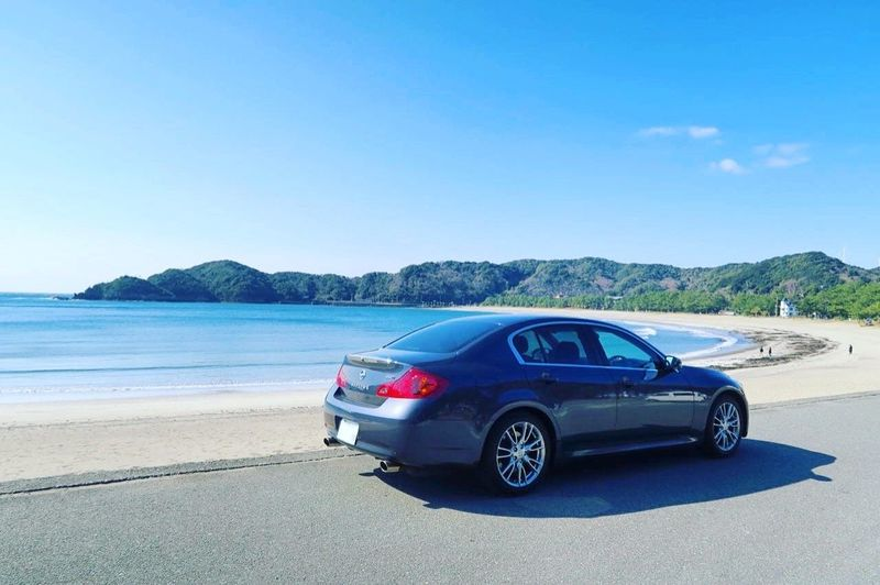 Car Blue Sea Transportation Sunlight Beach Nature Outdoors Sky Day No People Water Beauty In Nature Infiniti