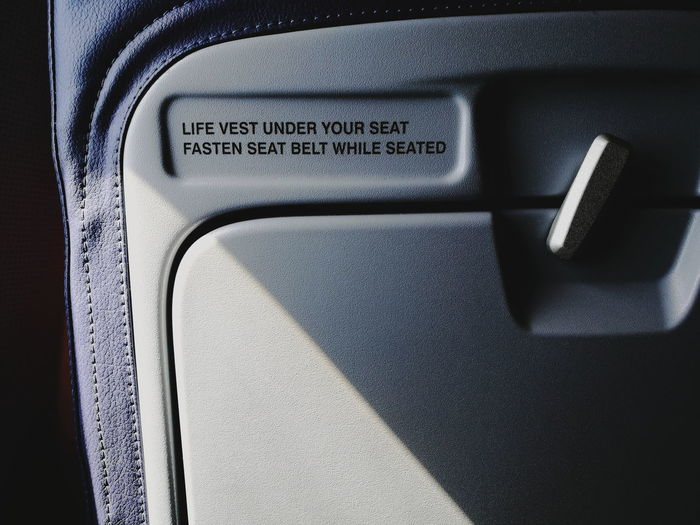 Close-up Indoors  Airplane Seatbelt Warning Sign Warning Life Vest The Week On EyeEm Be. Ready. The Traveler - 2018 EyeEm Awards The Great Outdoors - 2018 EyeEm Awards