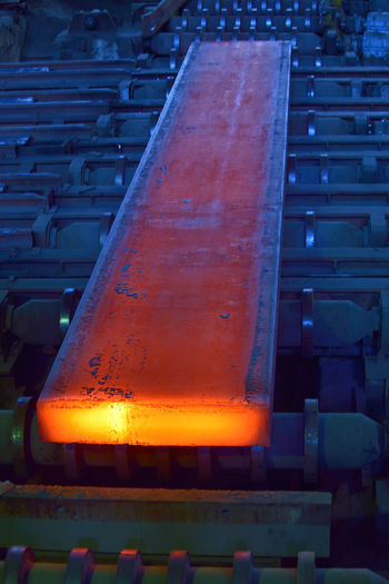 hot steel on conveyor inside of steel plant Close-up Hot Steel On Conveyor Inside Of Steel Plant Night No People Outdoors Steel; Mill; Metal; Molten; Production; Rolling; Fuel; Closeup; Technical; Spark; Heavy; Foundry; Generator; Intensive; Red; Power; Pollution; Business; Iron; Temperature; Burner; Welding; Orange; Stove; Furnace; Process; Conveyor; Burn; Melting; Generati