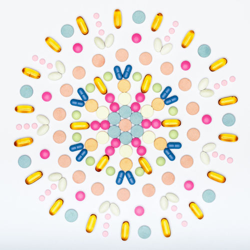 Assortment of various colourful pills on white background. Creative medication and prescription pills flat lay background. Colourful Drug Industry PainKiller Pills Abuse Addiction Allergy Antibiotic Antihistamine Background Blue Flat Lay Medication Minimal Minimalism Multicolored Pastel Pastel Colored Pill Prescription Medicine Still Life Tablets Top View White