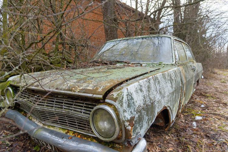 Old abandoned car on land