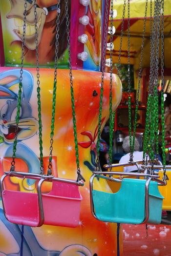 Carousel Chair Close-up Color Colored Day Fun Funfair Hanging Leisure Activity Merrygoround No People Outdoors Roundabout Roundabout Art