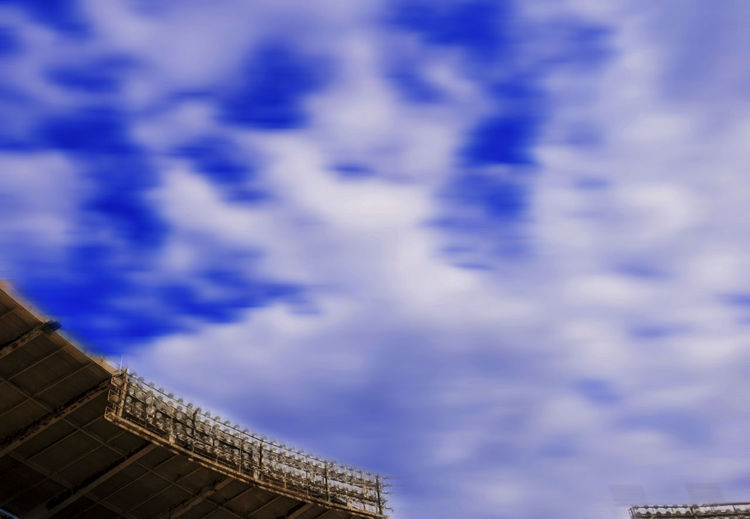 Floodlights Motion Blur Stadium Abandoned Stadium Architecture Blue Building Exterior Built Structure Cloud - Sky Day Floodlights Over Stadium. Low Angle View Nature No People Old Stadium Outdoors Sky