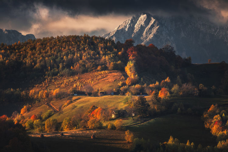 Autumn landscape with mountain villages near brasov, romania.