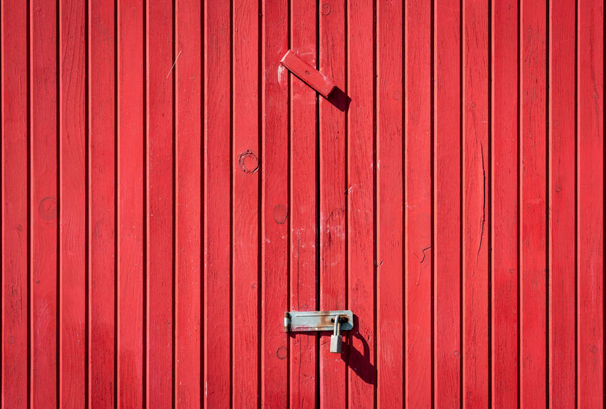 Partner Collection The EyeEm Collection Red Safety Security Protection Closed Entrance Metal Pattern No People Door Wood - Material Backgrounds Lock Full Frame Day Close-up Handle Latch Wall - Building Feature Security Camera Corrugated Red Security Entrance Built Structure Technology Architecture Sunlight
