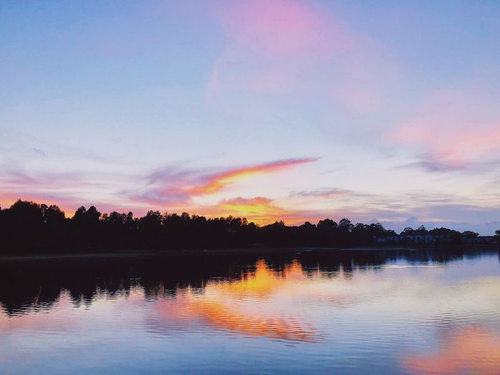 Water Sky Cloud - Sky Tranquility Lake Scenics - Nature Beauty In Nature Reflection Tranquil Scene Sunset Tree Nature Plant No People Silhouette Non-urban Scene Multi Colored Idyllic Orange Color Outdoors