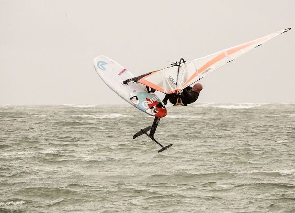 A windsurfer testing a new hydrofoil board off Hayling Island in Hampshire, UK. Jamesjagger Sonyrx10iv Sonyrx10m4 Watersports England Hampshire  Hayling Island  Hydrofoiling Hydrofoil Windfoiling Windfoil Windsurf Windsurfing Nature Water Sea Sky Land Day Outdoors Beach Waterfront Sport