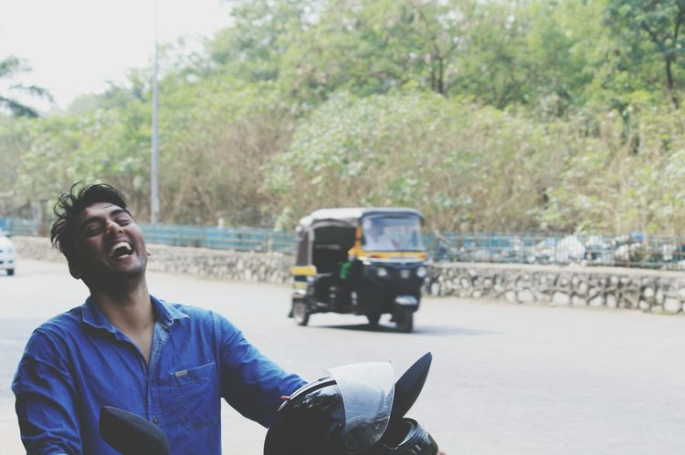 happiness Canonphotography Canonphotography Canon1100d India Streetphotography Happiness Laughing Laughter Adults Only Young Adult One Person Day Adult People Smiling One Young Man Only Cheerful Real People Men Road Outdoors Lifestyles Leisure Activity Riding Motorcycle