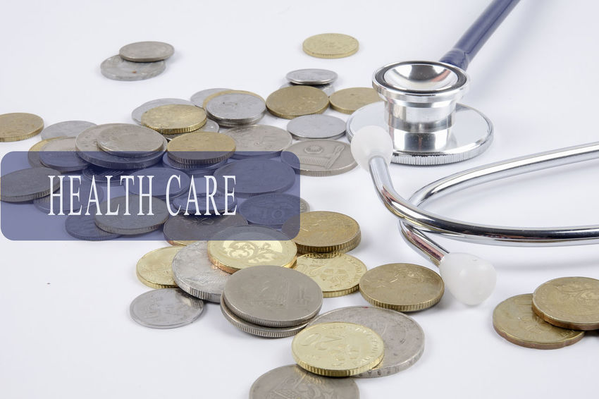 MEDICAL COST WITH STETHOSCOPE AND COINS ON WHITE Banner Close-up Concert Photography Cost Health Care And Medical Healthy Indoors  Isolated White Background Medical Report Stethoscope  White Background White Background,