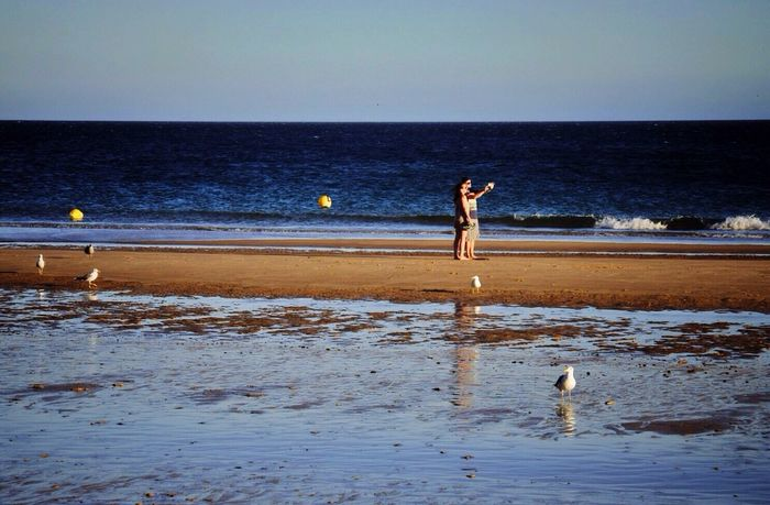 Simple Things In Life Watching People Taking Selfies Beachphotography Taking Photos Of People Taking Photos The Essence Of Summer Love Is In The Air Melancholic Landscapes Hollidayseason Porto De Mos Praia