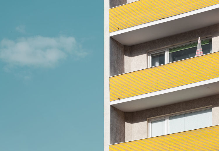 Sun Kissed Archidaily Architectural Detail Architecture Balcony Blue Blue Sky Building Exterior Minimalist Pastel Perspective Repetition Residential Building Sky Yellow