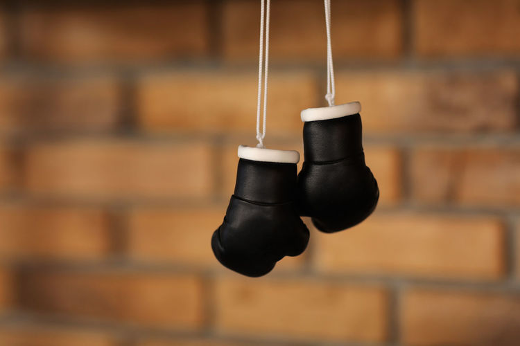 Close-up of shoes hanging on wall