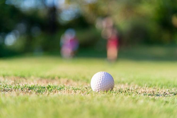Close-up of golf ball on grass