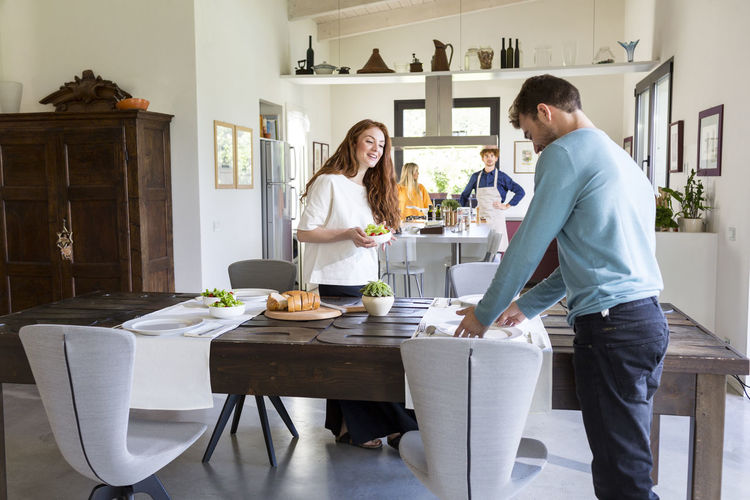 Couple standing by food at home
