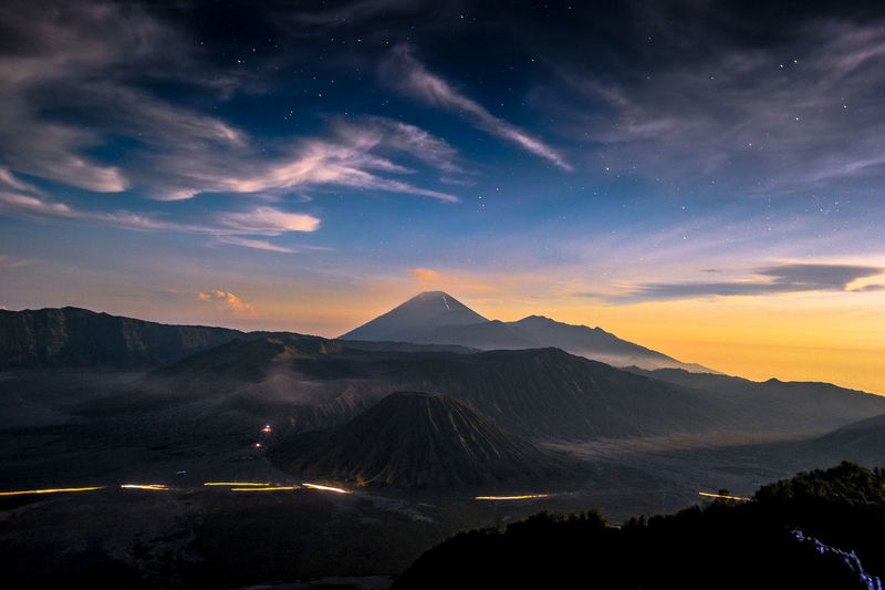 Idyllic View Of Mt Bromo And Mt Semeru Against Sky At Dusk