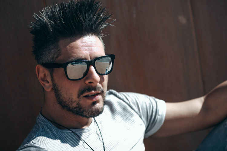 Glasses One Person Beard Young Adult Young Men Real People Portrait Headshot Front View Lifestyles Leisure Activity Eyeglasses  Facial Hair Sunglasses Casual Clothing Men Indoors  Close-up Mid Adult Men Fashion